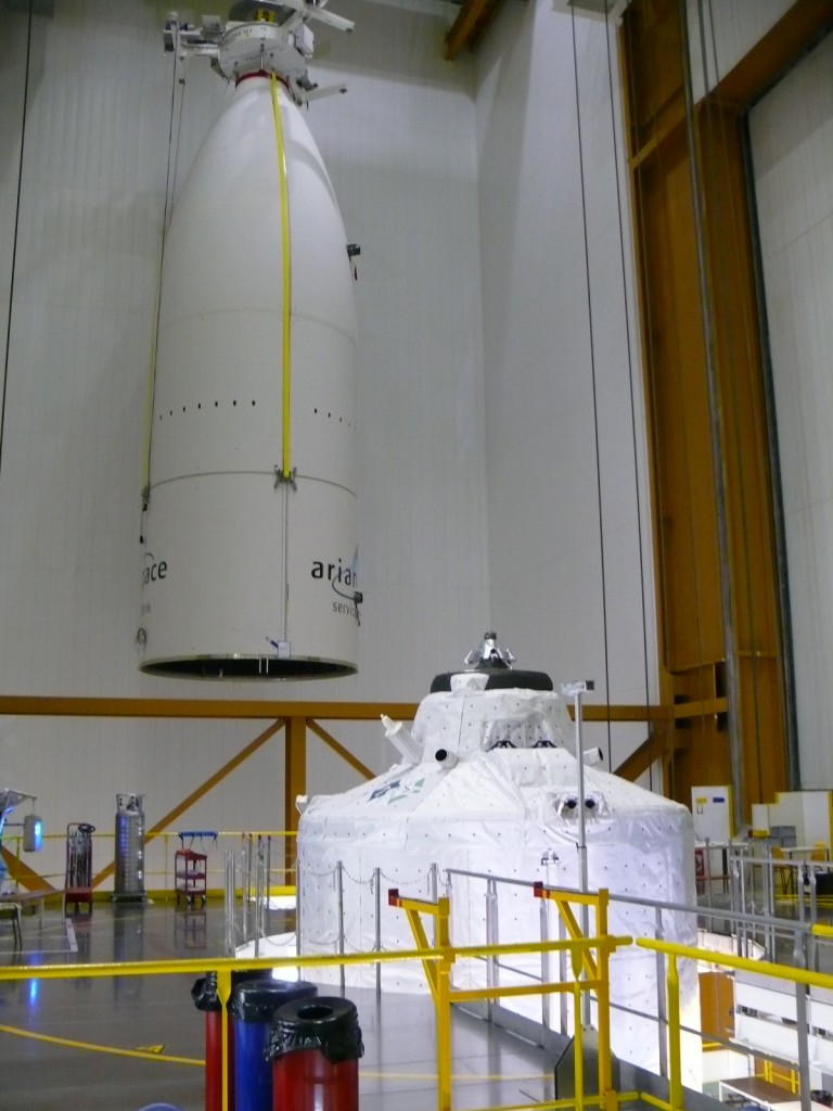 Ariane 5's huge fairing about to be lifted into place over ATV-3 Credit: ESA/A. Novelli