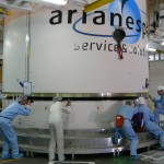 Ariane 5's aerodynamic fairing almost settled into place over ATV-3 Credit: ESA/A. Novelli