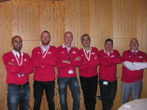 Six members of the ATV-4 team, correctly attired! (The other 13 people present at ESTEC that day for the post-flight board meeting were not 'allowed' in this picture because they had forgotten to wear their ATV-4 shirts!) Credit: ESA