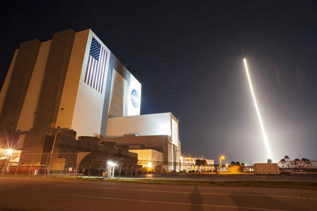 Tracking and Data Relay Satellite-K, streaks past the Vehicle Assembly Building and Launch Complex 39 at Kennedy Space Center after launching from Space Launch Complex 41 at 8:48 p.m. EST. Credit: NASA