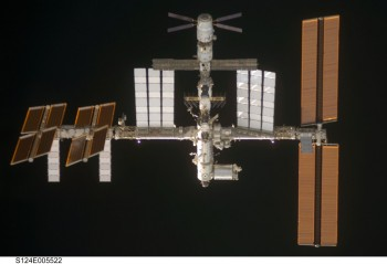 Old picture (June 2008) showing ATV-1 at the top (with the X-shaped solar arrays) and Columbus bottom right (white arrow). Note that the ISS has evolved since then! Credit: NASA