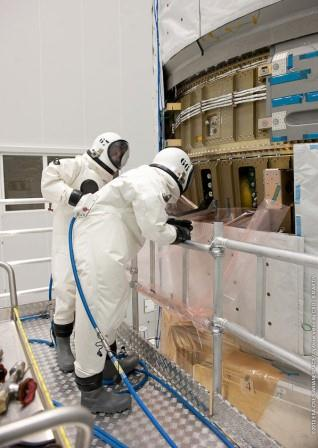 As you can see it is not the most comfortable working attire... Credit: ESA