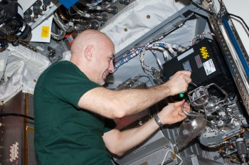 29 July 2013 --- ESA astronaut Luca Parmitano, Expedition 36 flight engineer, performs maintenance on the Water Pump Assembly 2 / Thermal Control System (WPA2/TCS) in the Columbus laboratory of the International Space Station. The pump was delivered to space via ATV-4. Credit: ESA/NASA