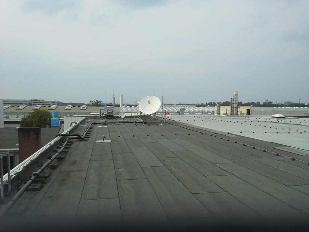 Two parabolic dishes are located on the roof of the ATV integration building at Astrium/Bremen. One is pointed toward NASA's relay satellite (TDRS6 - located near south America), and one is pointed toward ESA's Artemis. Credit: Astrium