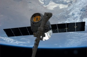 """This image of SpaceX Dragon grappled by Canadarm2 on 20 April 2014 was sent down by Flight Engineer Steve Swanson to Instagram with the message, """"We have a Dragon. All is good."""" Image Credit: NASA"""