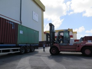You can see a corner of the ICC container standing behind the truck, waiting for transport to the harbour. Credit: ESA