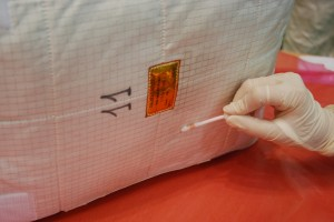 Checking cleanliness of ATV cargo bag. Credit: ESA
