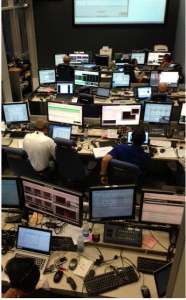 The Engineering Support Team; tonight the set up is augmented by the team responsible for this ATV-5 experiment. The EST is in room M27 and M34 (the two rooms are connected via camera). Credit: ESA