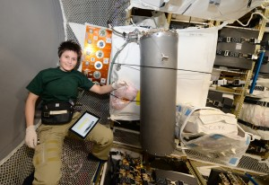 ESA astronaut Samantha Cristoforetti loading brine on ATV-5 , December 2014. Credits: ESA/NASA