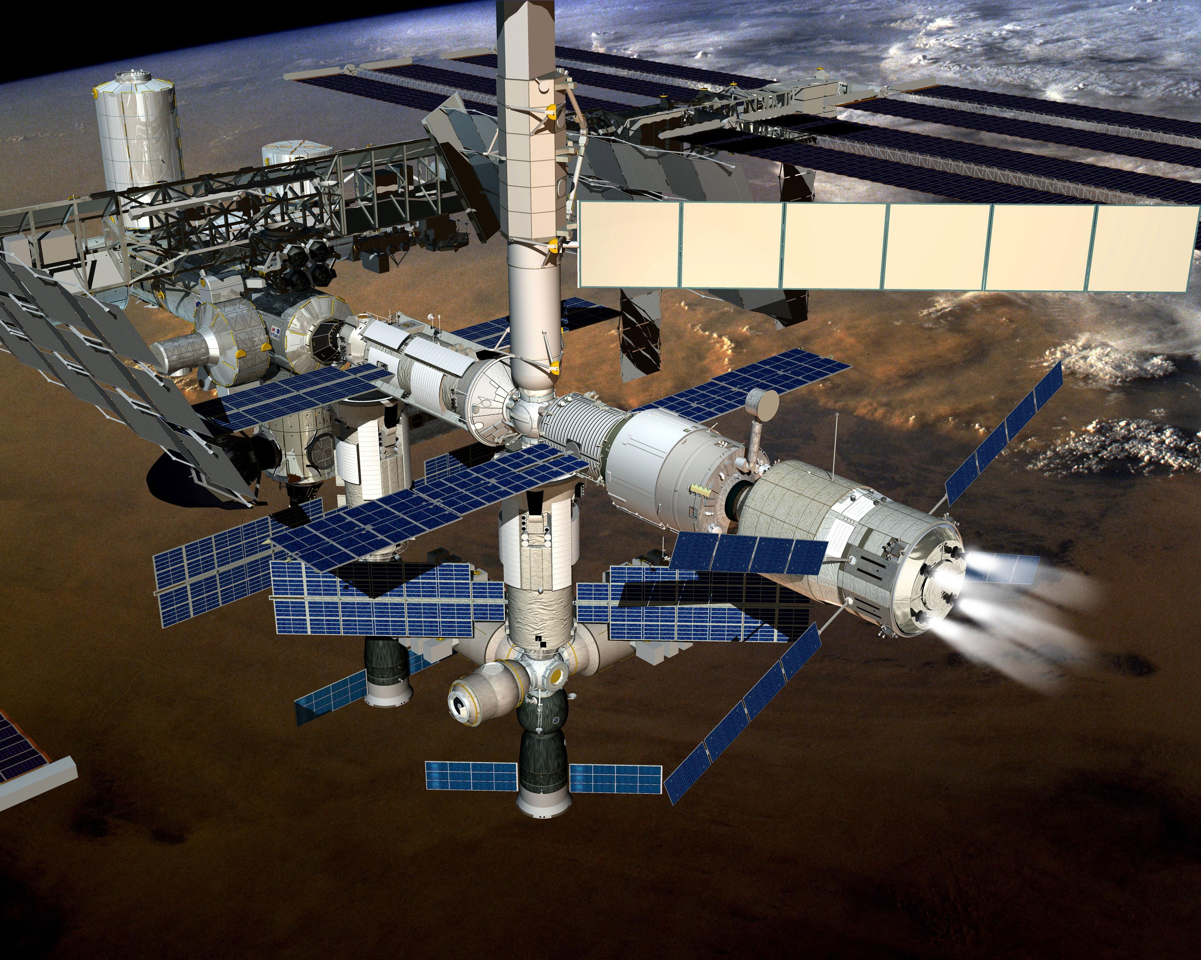 ISS orbiting backwards while ATV deboosts it Credit: ESA