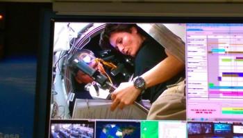 ESA astronaut Samantha Cristoforetti working with Russian cosmonaut Sasha Samokutyaev to close the ATV-5 hatch. Credit: ESA/NASA