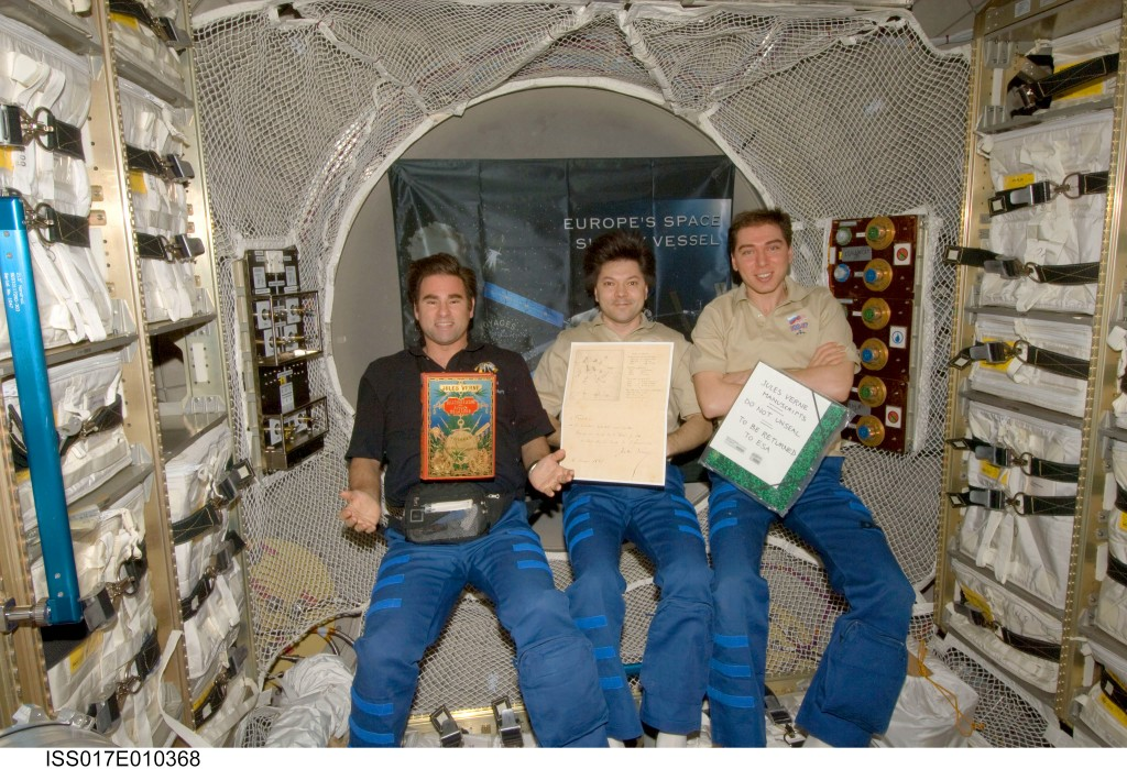 Space Station Expedition 17 crew holding Jules Verne book and manuscript inside ATV Jules Verne. Credits: NASA