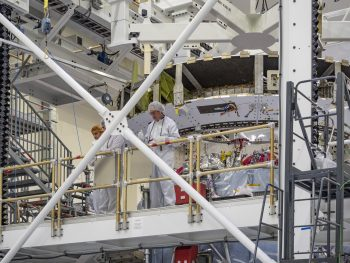 Discussion while connecting European Service Module to Crew Module Adapter. Credits: NASA–R. Sinyak