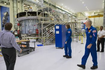 NASA astronaut candidate Kayla Barron and NASA astronaut Randy Bresnik looking at the European Service Module and Crew Module Adapter at Kennedy Space Center, 12 February. Credits:NASA–Kim Shiflett