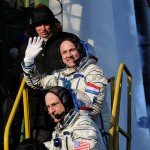 Expeditions 30 and 31 crew members greeting audience at the launch pad