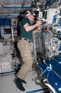 NASA astronaut Mike Fossum performing the PASSAGES experiment in the Columbus module
