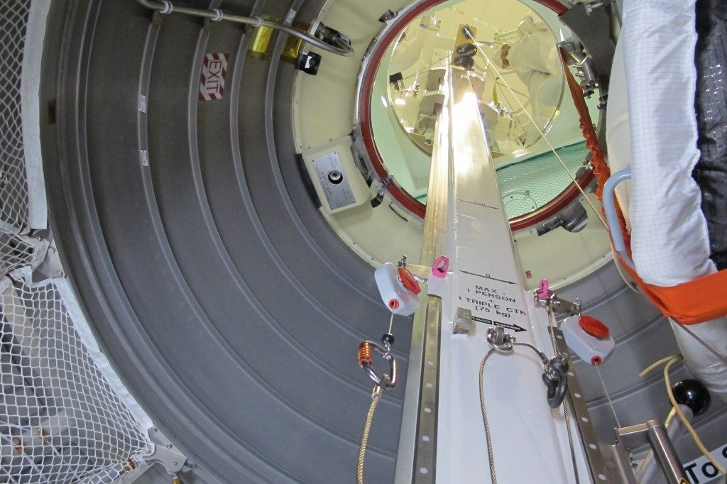 View from inside ATV looking up at the hatch.  The operator was ready for the first cargo bag. Credit: ESA