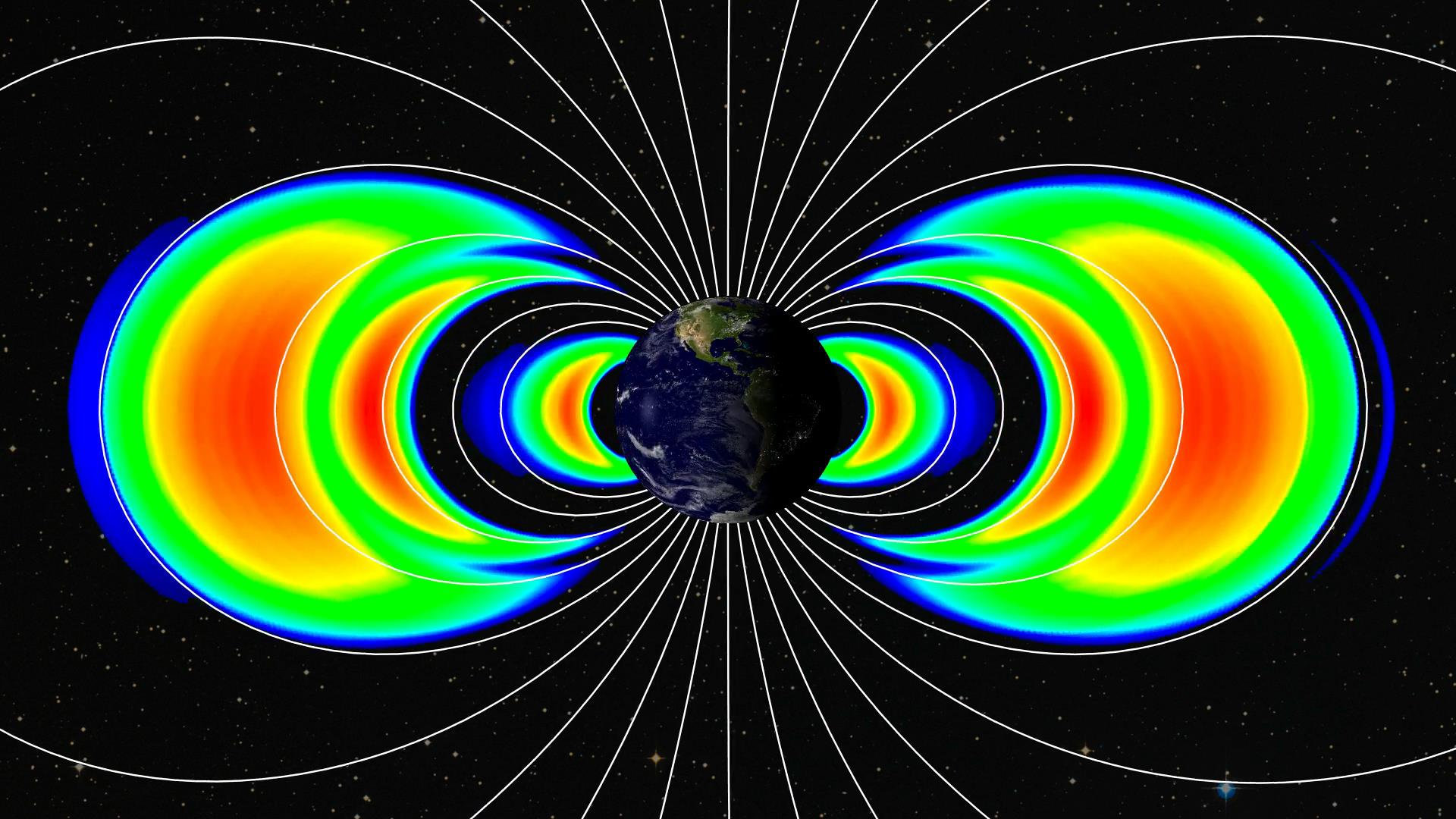 This image was created using data from the Relativistic Electron-Proton Telescopes on NASA's twin Van Allen Probes. It shows the emergence of a new third transient radiation belt. The new belt is seen as the middle orange and red arc of the three seen on each side of the Earth. Image Credit: APL, NASA