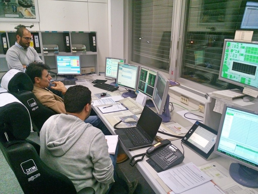 Giulio Pinzan, the Power and Thermal Engineer, Piergiorgio Pirroni, the Spacecraft Controller, and Charlie Amin, the AOCS engineer, ready to start the test. Credit: ESA