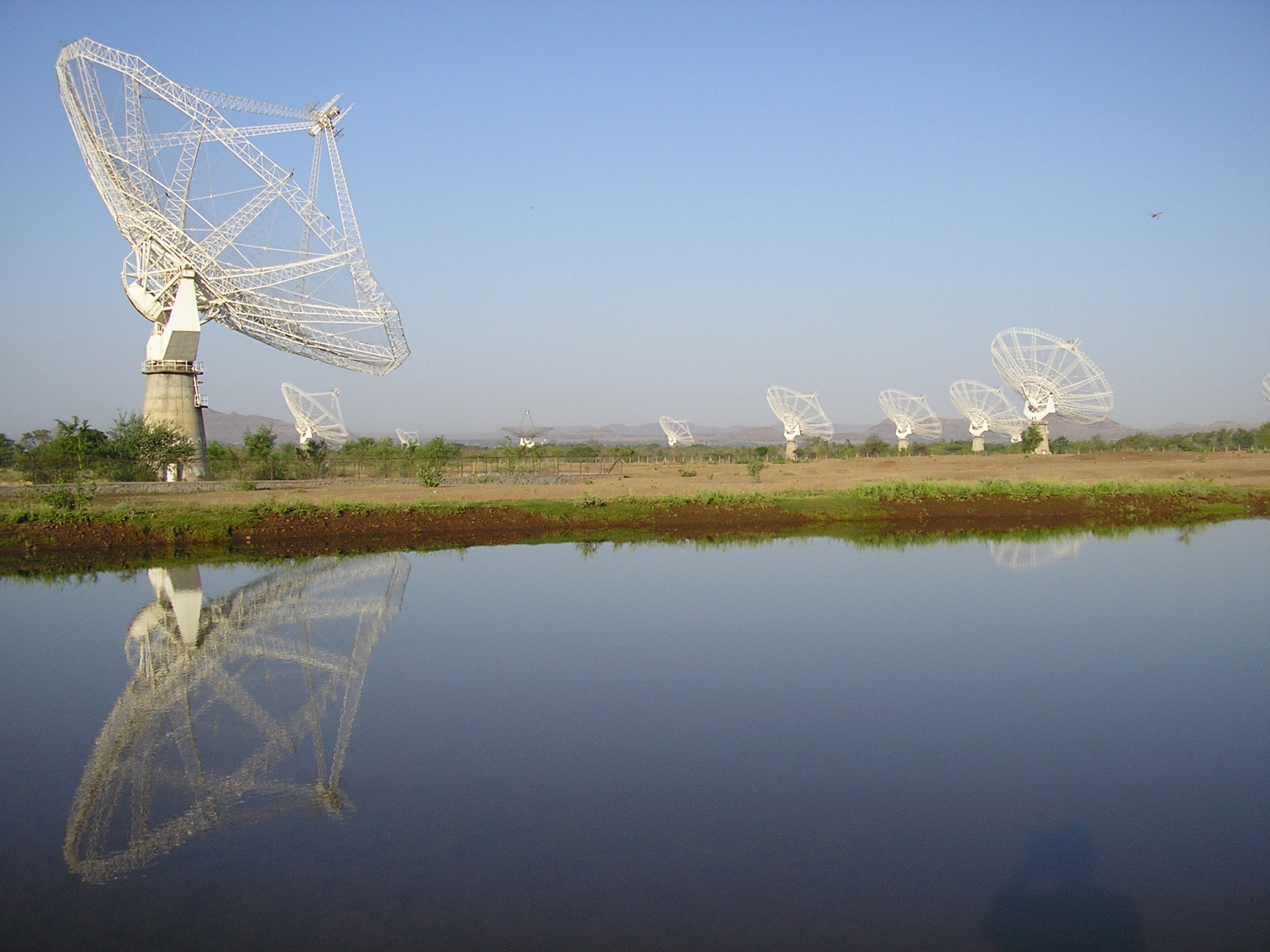 The Giant Metrewave Radio Telescope for radio astronomical research at metre wavelengths. GMRT is a very versatile instrument for investigating a variety of radio astrophysical problems ranging from nearby Solar system to the edge of observable Universe. Credit: National Centre for Radio Astrophysics - Tata Institute of Fundamental Research
