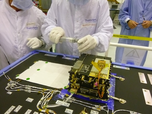 ESA's ExoMars Trace Gas Orbiter (TGO) carries two Electra radios provided by NASA. This image shows a step in installation and testing of the first of the two radios, inside a clean room at Thales Alenia Space, in Cannes, France, in June 2014. Credit: NASA/JPL-Caltech/ESA/TAS