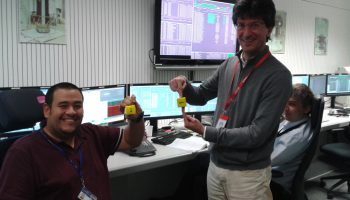 Jose Mendes and visiting scientist Daniele Bortoluzzi discussing what the test masses are doing as we perform repeated release attempts. Credit: ESA
