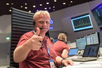 Spacecraft operations manager Peter Schmitz gives the thumbs up in the main control room at ESA's control centre in Darmstadt, Germany, on 19 October 2016, shortly after the ExoMars Trace Gas Orbiter arrived at the Red Planet. Credit: ESA/J. Mai