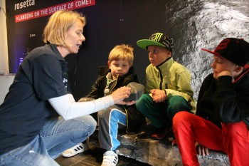 Rosita explaining the Rosetta mission to young visitors, as they sit on the mock comet inside the tour truck. Image courtesy Rosita Suenson.