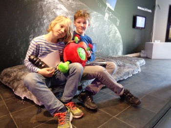 Young space enthusiasts sitting on the model comet with ESA Kids mascot Paxi in Copenhagen. Image courtesy: J. Makinen.