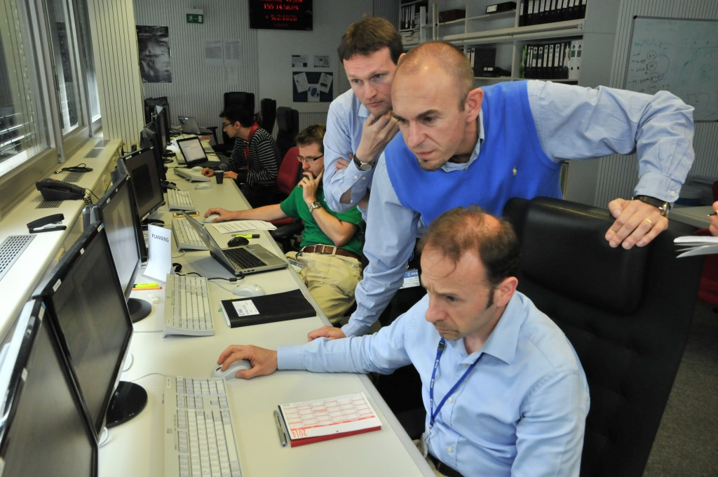 Some of the Rosetta flight control team at ESOC watching telemetry arrive from Rosetta during the second of three large orbit correction manoeuvres on 4 June 2014. Credit: ESA