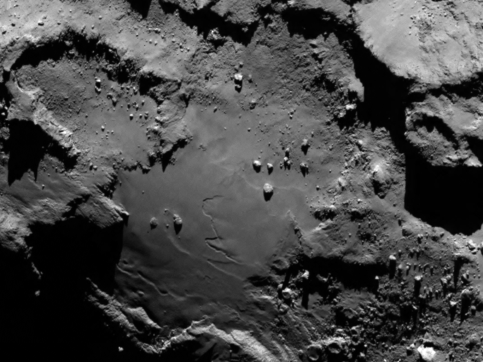 The lower side of 67P/C-G's larger lobe. The image was presented on the occasion of arrival on 6 Aug; it was taken from a distance of 130 km and the image resolution is 2.4 metres per pixel. Credits: ESA/Rosetta/MPS for OSIRIS Team MPS/UPD/LAM/IAA/SSO/INTA/UPM/DASP/IDA