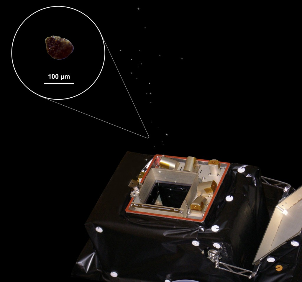 Representation of GIADA collecting comet dust. The inset shows an image taken with a stereo microscope of an analogue dust grain used in the laboratory for GIADA calibration activities. The image was prepared with GIADA consortium material by M. Ferrari and V. Galluzzi. Credit: ESA/Rosetta/GIADA/Univ Parthenope NA/INAF-OAC/IAA/INAF-IAPS