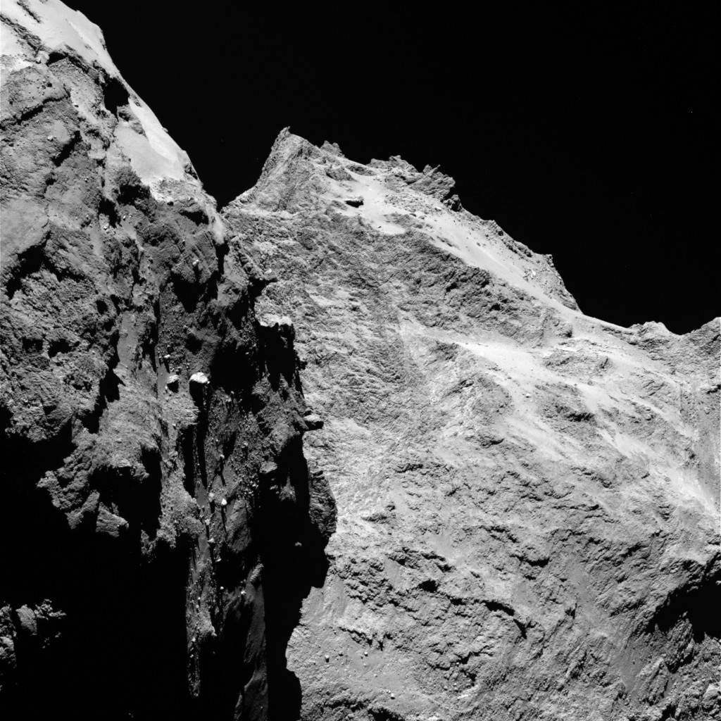 Jagged cliffs and prominent boulders are visible in this image taken by OSIRIS on 5 September 2014 from a distance of 62 kilometres from comet 67P/Churyumov-Gerasimenko. The left part of the image shows a side view of the comet's 'body', while the right is the back of its 'head'. One pixel corresponds to 1.1 metres. Credits: ESA/Rosetta/MPS for OSIRIS Team MPS/UPD/LAM/IAA/SSO/INTA/UPM/DASP/IDA