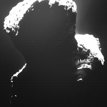 A rare glimpse at the dark side of Comet 67P/Churyumov-Gerasimenko. Light backscattered from dust particles in the comet's coma reveals a hint of surface structures. This image was taken by OSIRIS, Rosetta's scientific imaging system, on 29 September 2014 from a distance of approximately 19 kilometres. ESA/Rosetta/MPS for OSIRIS Team MPS/UPD/LAM/IAA/SSO/INTA/UPM/DASP/IDA
