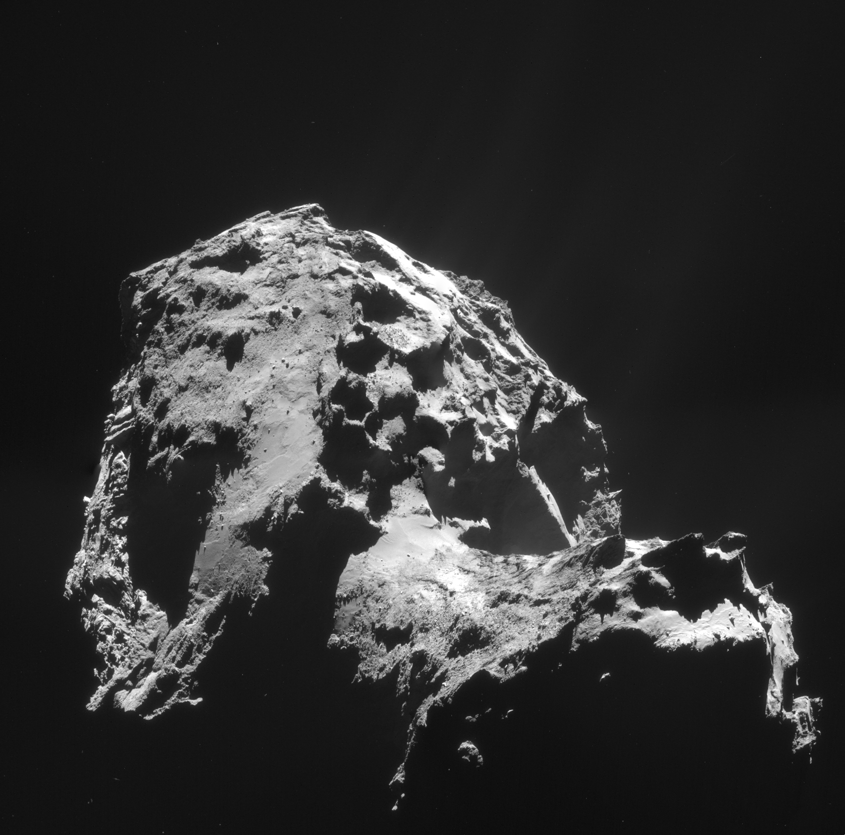 Four-image mosaic of Comet 67P/C-G comprising images taken on 1 January 2015. Credits: ESA/Rosetta/NAVCAM – CC BY-SA IGO 3.0