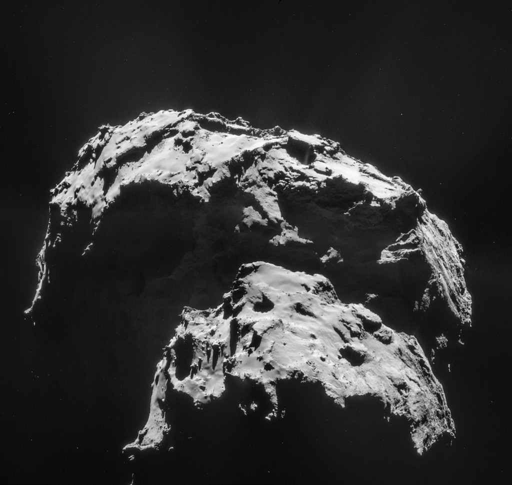 Four image mosaic comprising images taken on 21 January 2015 by Rosetta's Navigation Camera (NAVCAM). Rotation and translation of the comet during the imaging sequence make it difficult to create an accurate mosaic, and there may be some spurious spatial and intensity features as a result of the mosaic-making sequence, so always refer to the individual frames before performing any detailed comparison or drawing conclusions about any strange structures or low intensity extended emission.Indeed, for this image set, thefeature near the centre of the mosaic is a compromise of the top two frames.Credits: ESA/Rosetta/NAVCAM – CC BY-SA IGO 3.0