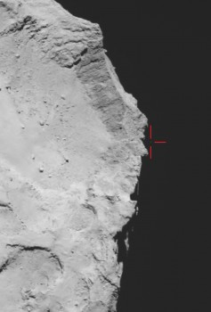 Rosetta's OSIRIS wide-angle camera captured this view of Comet 67P/Churyumov–Gerasimenko on 12 November 2014 at 17:18 GMT (onboard spacecraft time), with what is thought to be Philae above the rim of the large depression (marked). The image has been used to guide subsequent lander search efforts, and provides the basis for trajectory reconstructions. Credits: ESA/Rosetta/MPS for OSIRIS Team MPS/UPD/LAM/IAA/SSO/INTA/UPM/DASP/IDA
