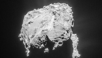 Cropped and processed single frame NAVCAM image of Comet 67P/C-G taken on 20 March 2015 from a distance of 81.7 km to the comet centre. This cropped version measures about 5.8 x 6.1 km. The image is lightly processed to bring out the details of the outflowing material. Credits: ESA/Rosetta/NAVCAM – CC BY-SA IGO 3.0