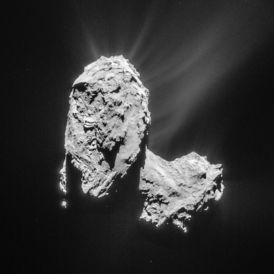 Cropped and processed single frame NAVCAM image of Comet 67P/C-G taken on 21 March 2015 from a distance of 82.6 km to the comet centre. This cropped version measures about 6.2 x 6.2 km. The image is lightly processed to bring out the details of the outflowing material. Credits: ESA/Rosetta/NAVCAM – CC BY-SA IGO 3.0