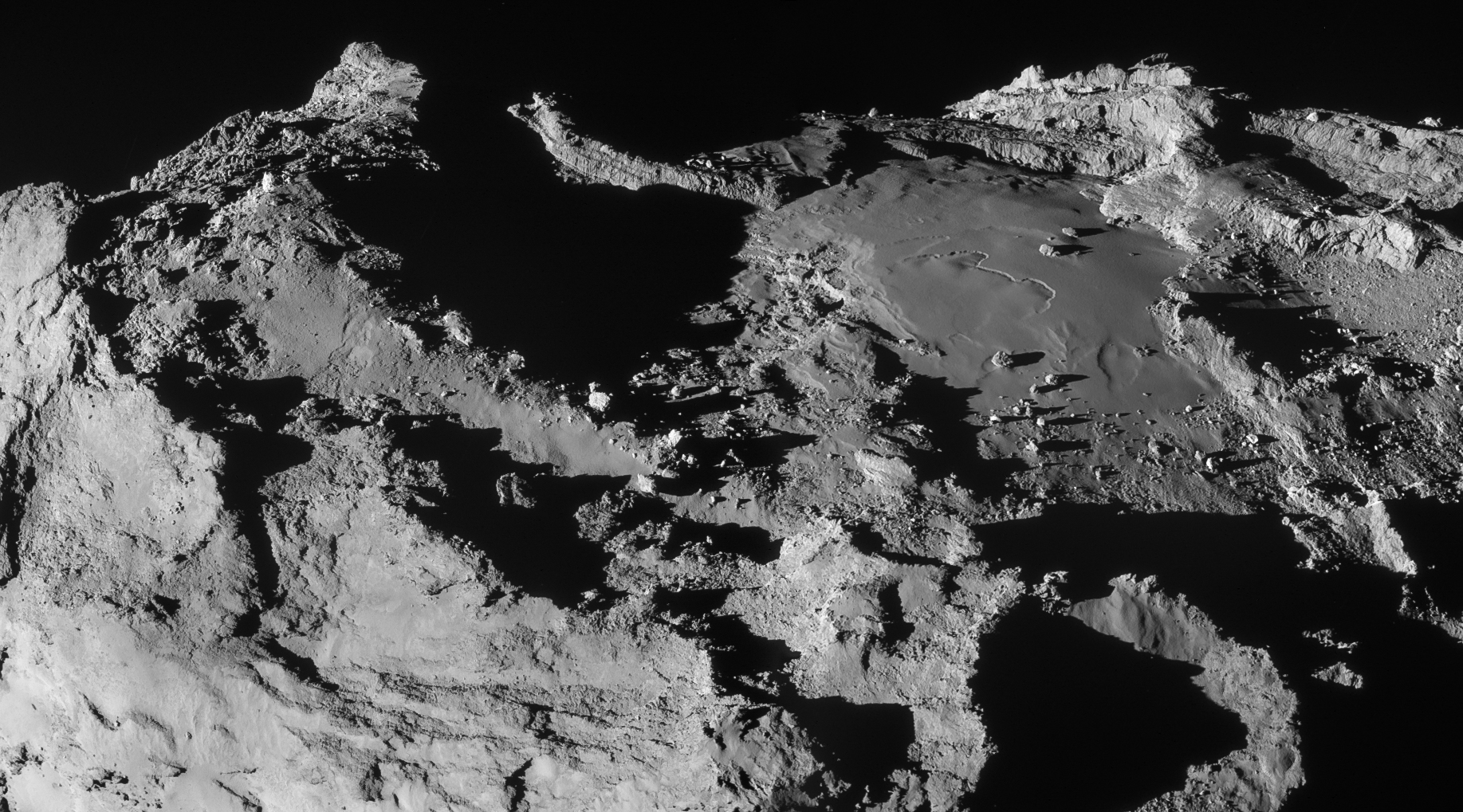 This stunning scene was created from two NAVCAM frames acquired at 19.9 km from the comet centre on 28 March. The scale is about 1.7 m/pixel and the image measures 3.1 x 1.7 km. The image has been adjusted for intensity and contrast, and the vignetting has been fixed.