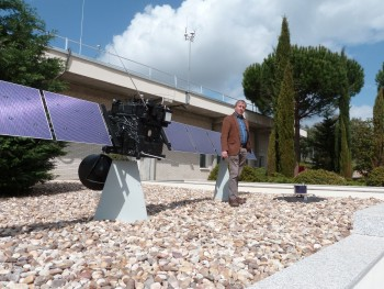 Patrick stands beside a 1:4 scale model of Rosetta and Philae at ESAC, Spain.  Credit: ESA