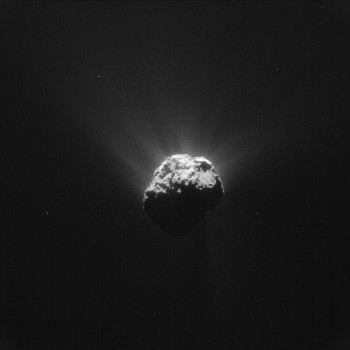 This image was taken by Rosetta's NavCam at 19:38 GMT on 13 June 2015, shortly before Philae's wake-up signal was received. The signals were relayed by the Rosetta orbiter and received at ESA's European Space Operations Centre in Darmstadt at 20:28 GMT.  The image was taken from a distance of 201 km from the centre of Comet 67P/Churyumov–Gerasimenko and measures 17.5 km across. The image scale is 17.1 m/pixel. The comet is orientated with the small lobe towards the right, with the large depression known as Hatmehit visible. Philae is thought to be resting just outside the rim, towards the top right in this image.  Credits: ESA/Rosetta/NavCam – CC BY-SA IGO 3.0