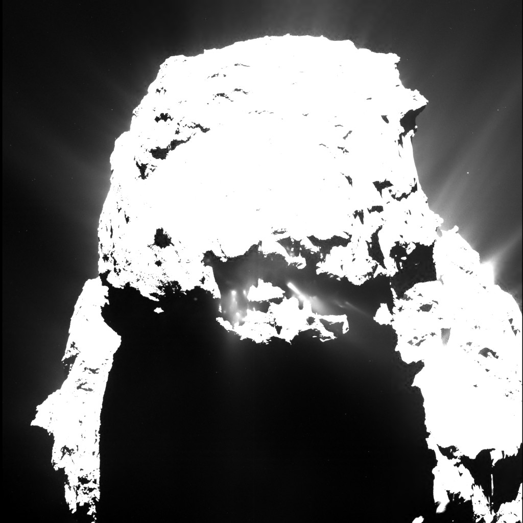 Comet 67P/C-G on 25 April 2015, from a distance of approximately 93 kilometres, seen through the narrow-angle OSIRIS camera. The image shows jets emanating from the comet's small lobe after nightfall. The image exposure time was 0.096s.  Credits: ESA/Rosetta/MPS for OSIRIS Team MPS/UPD/LAM/IAA/SSO/INTA/UPM/DASP/IDA
