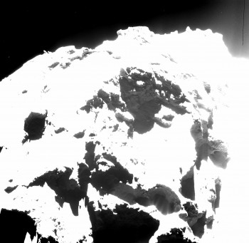 Active pits detected in the Seth region of Comet 67P/Churyumov¬Gerasimenko can be seen in the lower right portion of this OSIRIS wide-angle camera image. The largest, Seth_01, measures 220 m across and 185 m deep. Seth_02 and Seth_03 lie immediately to the left and measure 110 m and 140 m across, respectively.  The contrast of the image has been deliberately stretched to reveal the details of the fine-structured jets against the shadow of the pit, which are interpreted as dusty streams rising from the fractured wall of the pit. The image was acquired on 20 October 2014 from a distance of 7 km from the surface of the comet.  Credits: ESA/Rosetta/MPS for OSIRIS Team MPS/UPD/LAM/IAA/SSO/INTA/UPM/DASP/IDA