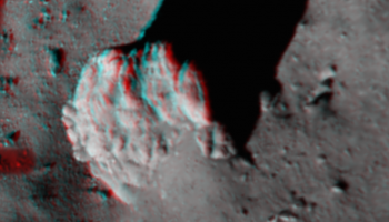 This image, created from Philae's ROLIS descent camera, focuses on the largest boulder seen in the image captured at 67.4 m above Comet 67P/Churyumov–Gerasimenko. It is best viewed with red/blue–green glasses. The 3D view highlights the fractures in the 5 m-high boulder, along with the tapered 'tail' of debris and excavated 'moat' around it. Credits: ESA/Rosetta/Philae/ROLIS/DLR