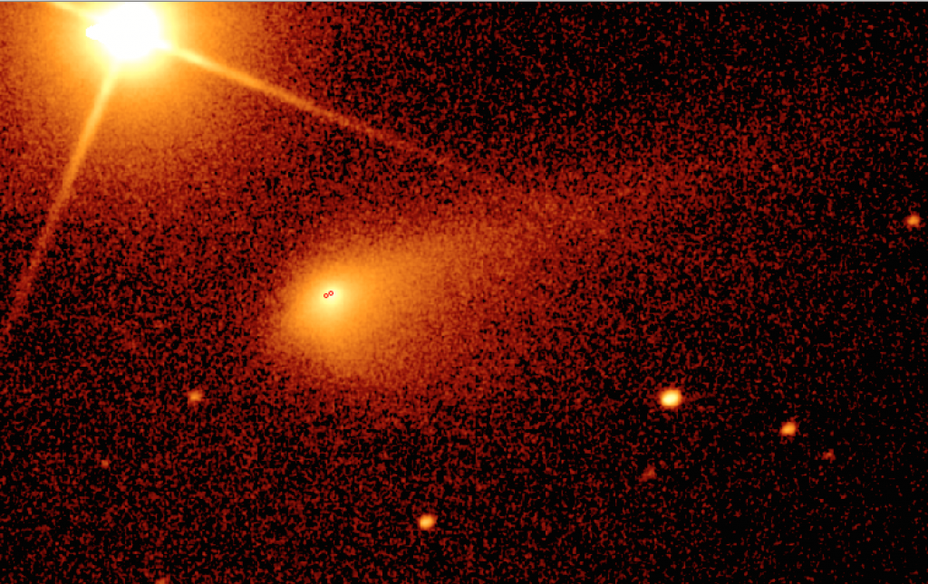 Caption: 20 second R-band exposure of Comet 67P/C-G using the Liverpool Telescope on 30 September 2015. The bottom image has been marked with two red dots to indicate the position of the nucleus and Rosetta, which was separated from the nucleus by 1500 km around this time. The comet was about 205 million km from the Sun on 30 September. The field of view is approximately 4.5 x 2.8 arcminutes, or 270,000 x 170,000 km. Credits: Alan Fitzsimmons / Liverpool Telescope