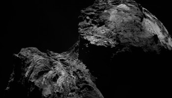 Single- frame OSIRIS narrow-angle camera image taken on 10 December 2015, when Rosetta was 103.2 km from the nucleus of Comet 67P/Churyumov–Gerasimenko. The scale is 1.87 m/pixel. Credits: ESA/Rosetta/MPS for OSIRIS Team MPS/UPD/LAM/IAA/SSO/INTA/UPM/DASP/IDA