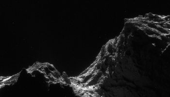 Enhanced NAVCAM image of Comet 67P/C-G taken on 24 April 2016, 28 km from the nucleus. The scale is 2.4 m/pixel and the image measures 2.4 km across. Credits: ESA/Rosetta/NAVCAM – CC BY-SA IGO 3.0.