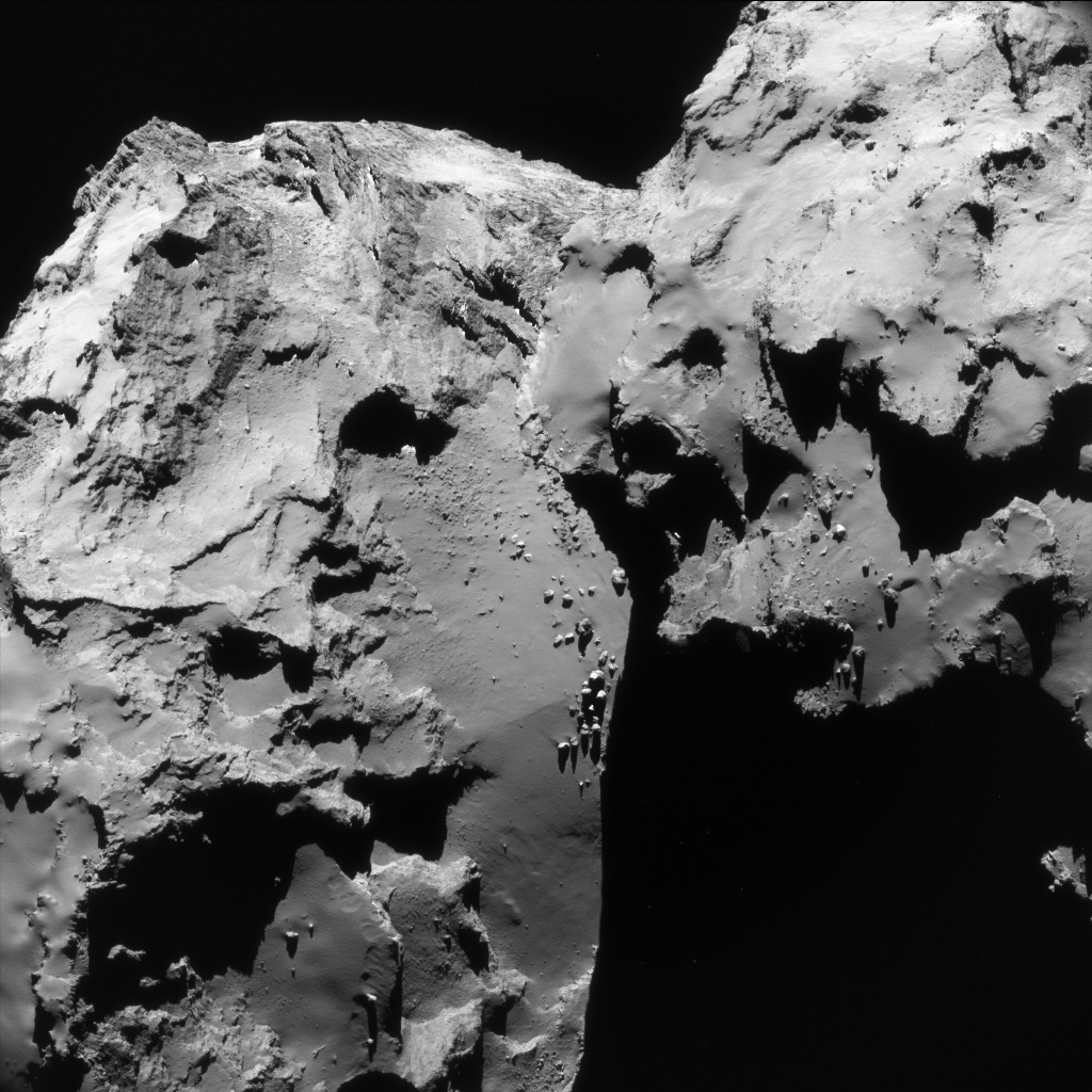 Enhanced single frame NAVCAM view on Comet 67P/C-G taken on 17 June 2016 from a distance of 30.8 km. The image scale is 2.6 m/pixel and the image measures 2.7 km across. Credits: ESA/Rosetta/NavCam – CC BY-SA IGO 3.0