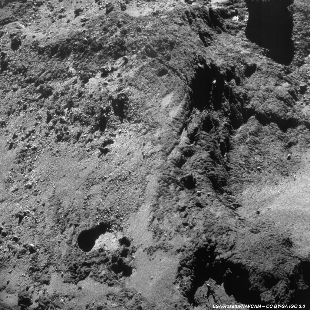 Enhanced NAVCAM image of Comet 67P/C-G taken on 30 May 2016, 7 km from the nucleus centre (about 6.5 km from the surface taking into account the orientation and inclination of the spacecraft with respect to the surface). The average scale is 0.55 m/pixel and the image measures about 570 m across. Credits: ESA/Rosetta/NAVCAM – CC BY-SA IGO 3.0